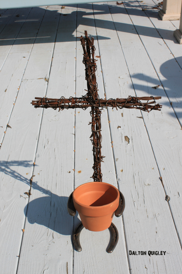 "Photo of a garden 4"" pot on a barbed wire cross."